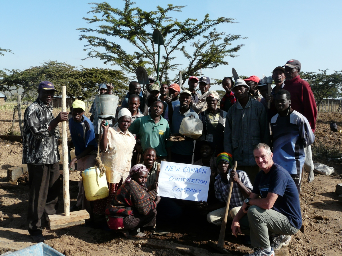A group of IDP's and a volunteer prepare to construct a new clinic.
