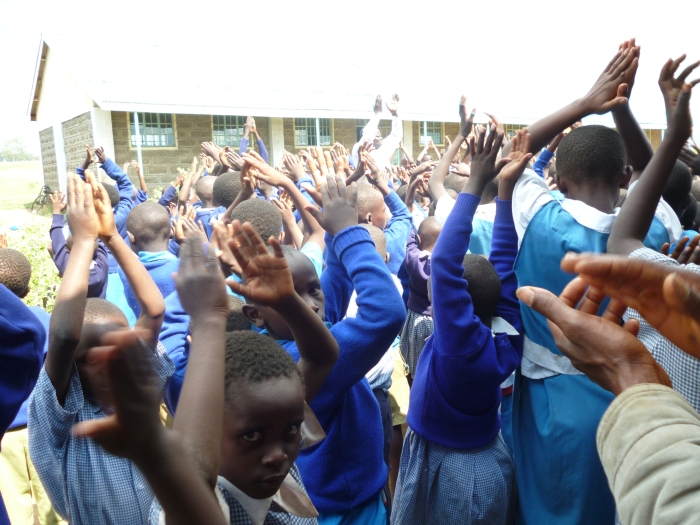 Students at Shalom Primary School celebrate the opening of their school.