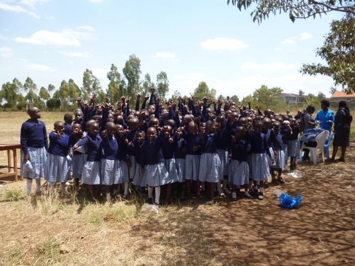 Students at Ndia-ini Primary School show off their new uniform jumpers!