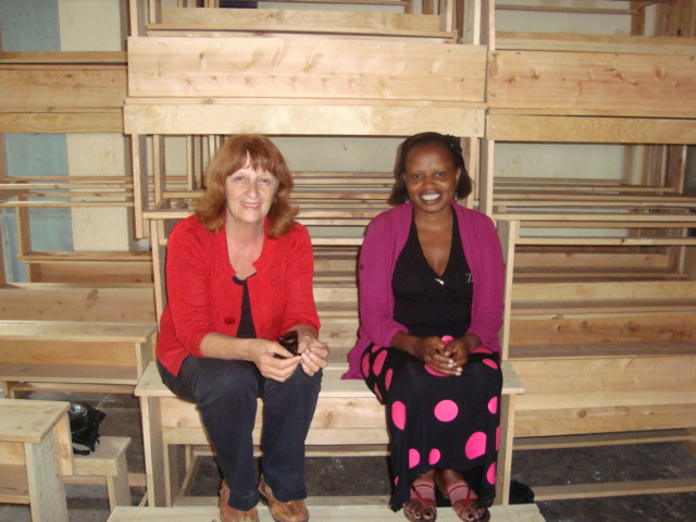 Annie with Irene, donating desks for a classroom at Manjani Mingi IDP Camp.