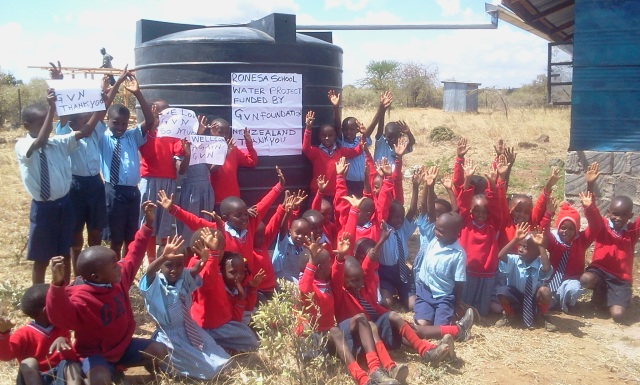 Children at Ronesa with their new water tank!