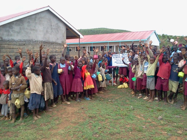 Students from Lemolo A pose in front of their new school.