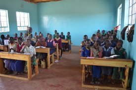 Students in their new classrooms with new seats.